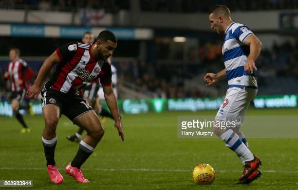 Conor Washington of Queens Park Rangers takes on Cameron CarterVickers of Sheffield United during the Sky Bet Championship match between Queens Park...