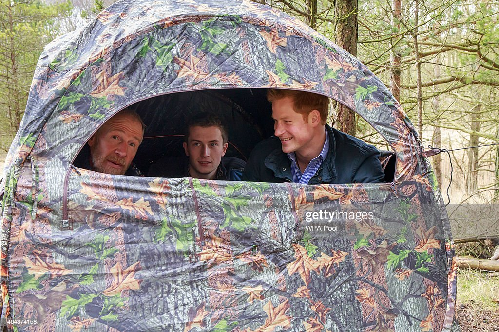 Conrad Dickinson, Will Nicholls and Prince Harry sit in a hide where Nicholls demonstrates how he uses the medium of wildlife photography to promote the conservation of red squirrels at Northumberland Wildlife Trust's Red Squirrel Northern England (RSNE) Project, where staff are working with the local community to safeguard the red squirrel (Sciurus vulgaris) population, with the main focus on a grey squirrel (Sciurus carolinensis) control programme at Frankham Woods on February 25, 2015 near Fourstones, United Kingdom.