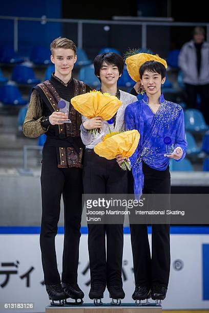 Conrad Orzel of Canada Jun Hwan Cha of Korea and Mitsuki Sumoto of Japan pose for a photo during the Junior Mens Medal Ceremony on day two of the ISU...