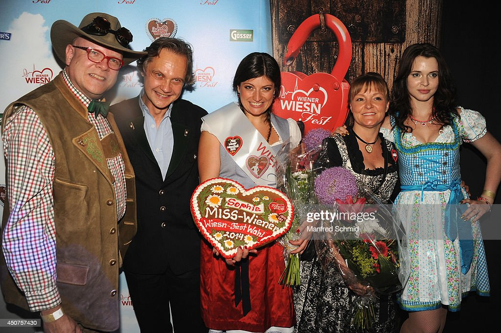 Conrad Seidl, Christian Feldhofer, Sophie Marie, Claudia Wiesner and Roxanne Rapp pose for a photograph during the beauty competition 'Miss Wiener Wiesn-Fest 2014' at Platzhirsch on on June 12, 2014 in Vienna, Austria.