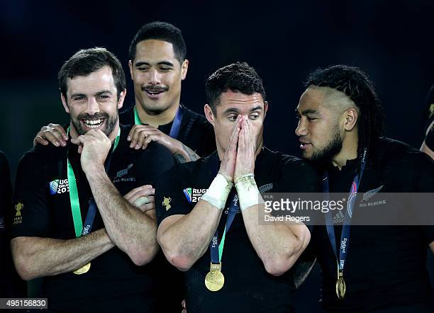Conrad Smith Aaron Smith Dan Carter and Ma'a Nonu of New Zealand celebrate their victory in the 2015 Rugby World Cup Final match between New Zealand...