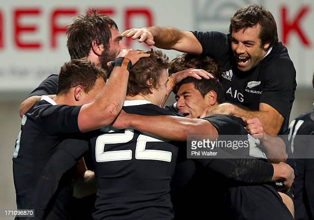 Conrad Smith and Charles Piutau of the All Blacks congratulate Beauden Barrett on his try during the Third Test Match between the New Zealand All...