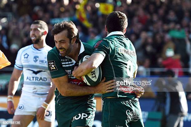 Conrad Smith and Thibault Daubagna of Pau celebrates scoring a try during the rugby Top 14 match between Pau and Montpellier at on December 31 2016...
