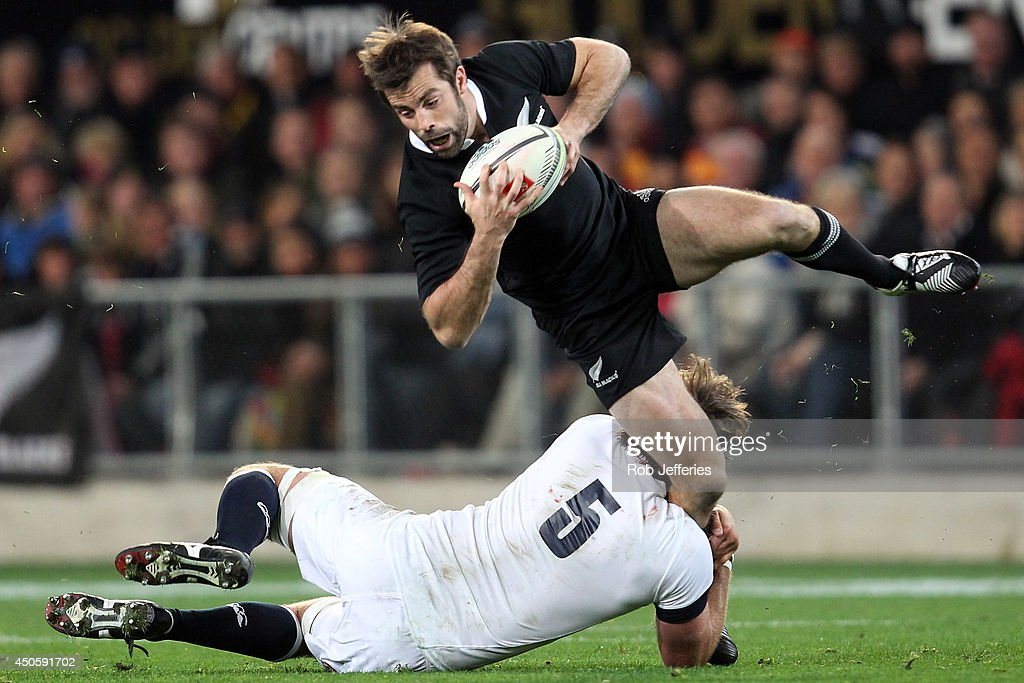 Conrad Smith of New Zealand is tackled by Geoff Parling of England during the International Test Match between the New Zealand All Blacks and England at Forsyth Barr Stadium on June 14, 2014 in Dunedin, New Zealand.