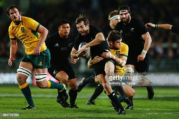 Conrad Smith of New Zealand is tackled by James Slipper of Australia during The Rugby Championship Bledisloe Cup match between the New Zealand All...