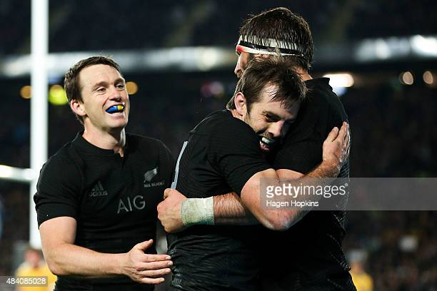 Conrad Smith of the All Blacks celebrates his try with teammates Ben Smith and Samuel Whitelock during The Rugby Championship Bledisloe Cup match...