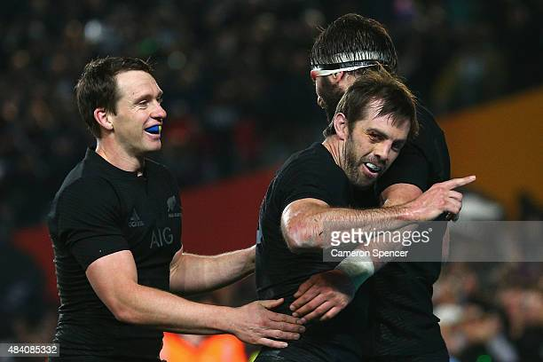 Conrad Smith of the All Blacks celebrates scoring a try with team mates Samuel Whitelock of the All Blacks and Ben Smith during The Rugby...