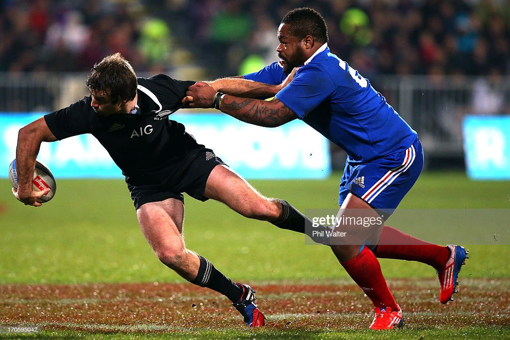 Conrad Smith of the All Blacks is tackled by Mathieu Bastareaud of France during the International Test match between the New Zealand All Blacks and France at AMI Stadium on June 15, 2013 in Christchurch, New Zealand.