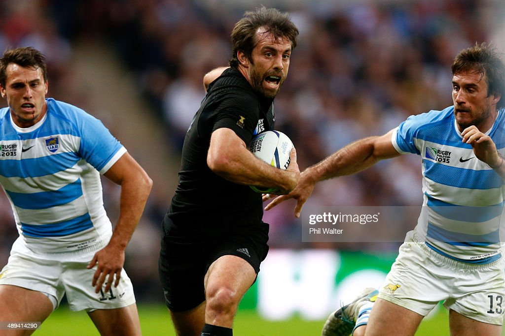 Conrad Smith of the All Blacks makes a break during the 2015 Rugby World Cup Pool C match between New Zealand and Argentina at Wembley Stadium on September 20, 2015 in London, United Kingdom.