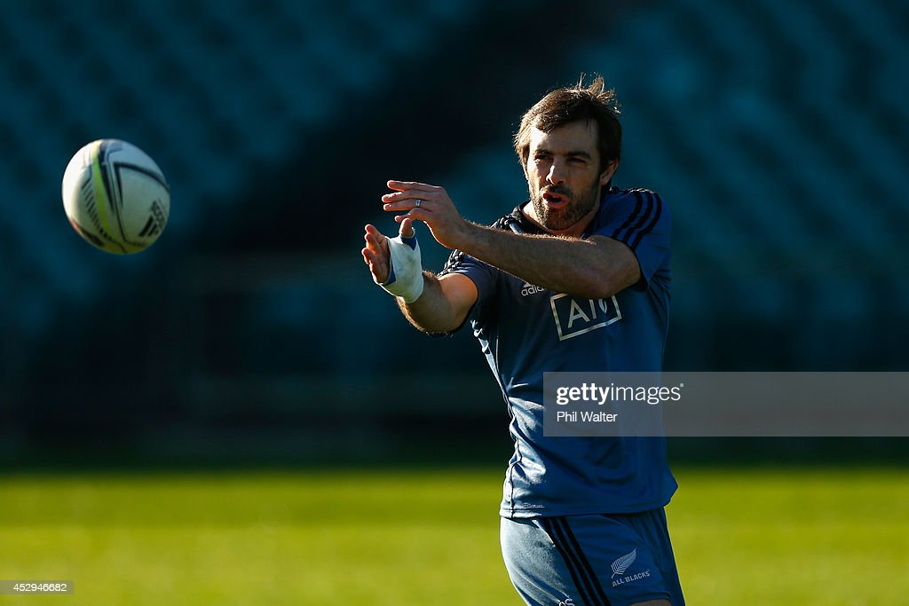 <a gi-track='captionPersonalityLinkClicked' href=/galleries/search?phrase=Conrad+Smith&family=editorial&specificpeople=644500 ng-click='$event.stopPropagation()'>Conrad Smith</a> of the All Blacks passes during a New Zealand All Blacks training session at North Harbour Stadium on July 31, 2014 in Auckland, New Zealand.