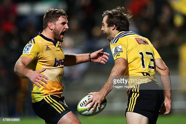 Conrad Smith of the Hurricanes celebrates his try with teammate Callum Gibbins during the round 18 Super Rugby match between the Chiefs and the...
