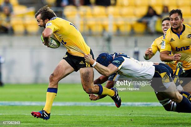Conrad Smith of the Hurricanes is tackled during the round four Super Rugby match between the Hurricanes and the Brumbies at Westpac Stadium on March...
