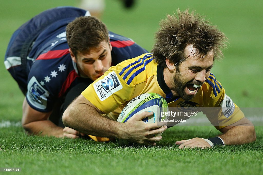 <a gi-track='captionPersonalityLinkClicked' href=/galleries/search?phrase=Conrad+Smith&family=editorial&specificpeople=644500 ng-click='$event.stopPropagation()'>Conrad Smith</a> of the Hurricanes scores a try past <a gi-track='captionPersonalityLinkClicked' href=/galleries/search?phrase=Tom+English&family=editorial&specificpeople=869091 ng-click='$event.stopPropagation()'>Tom English</a> of the Rebels during the round 13 Super Rugby match between the Rebels and the Hurricanes at AAMI Park on May 9, 2014 in Melbourne, Australia.
