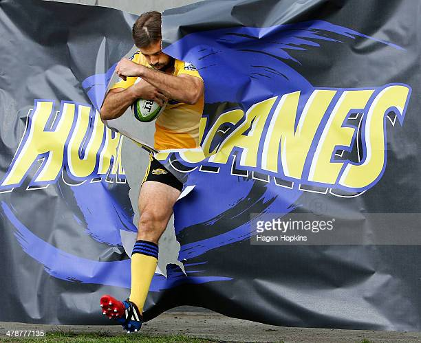 Conrad Smith of the Hurricanes takes the field for his 100th Super Rugby game during the round five Super Rugby match between the Hurricanes and the...