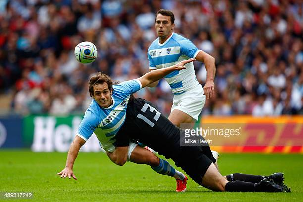 Conrad Smith of the New Zealand All Blacks tackles Nicolas Sanchez of Argentina during the 2015 Rugby World Cup Pool C match between New Zealand and...