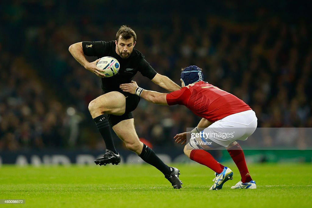 <a gi-track='captionPersonalityLinkClicked' href=/galleries/search?phrase=Conrad+Smith&family=editorial&specificpeople=644500 ng-click='$event.stopPropagation()'>Conrad Smith</a> of the New Zealand All Blacks takes on <a gi-track='captionPersonalityLinkClicked' href=/galleries/search?phrase=Bernard+Le+Roux&family=editorial&specificpeople=7397375 ng-click='$event.stopPropagation()'>Bernard Le Roux</a> of France during the 2015 Rugby World Cup Quarter Final match between New Zealand and France at the Millennium Stadium on October 17, 2015 in Cardiff, United Kingdom.
