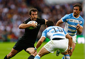 Conrad Smith of the New Zealand All Blacks takes on Joaquin Tuculet of Argentina during the 2015 Rugby World Cup Pool C match between New Zealand and...