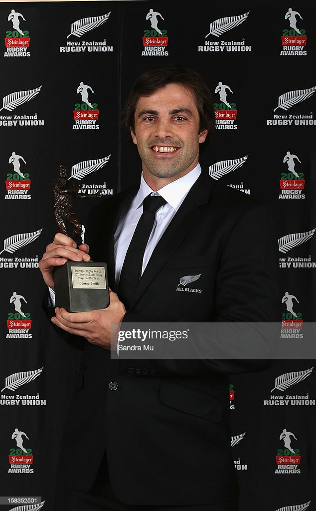 <a gi-track='captionPersonalityLinkClicked' href=/galleries/search?phrase=Conrad+Smith&family=editorial&specificpeople=644500 ng-click='$event.stopPropagation()'>Conrad Smith</a> poses with the Super Rugby Player of the Year award during the 2012 Steinlager Rugby Awards at SkyCity Convention Centre on December 14, 2012 in Auckland, New Zealand.