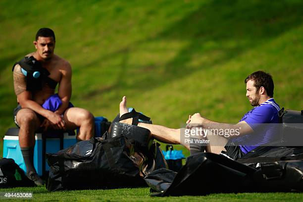Conrad Smith recovers following training with Jerome Kaino L during a New Zealand All Blacks training session at Pennyhill Park on October 27 2015 in...