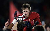 Conrad Ukropina of the Stanford Cardinal celebrates after he kicked the gamewinning field at the end of regulation to beat the Notre Dame Fighting...