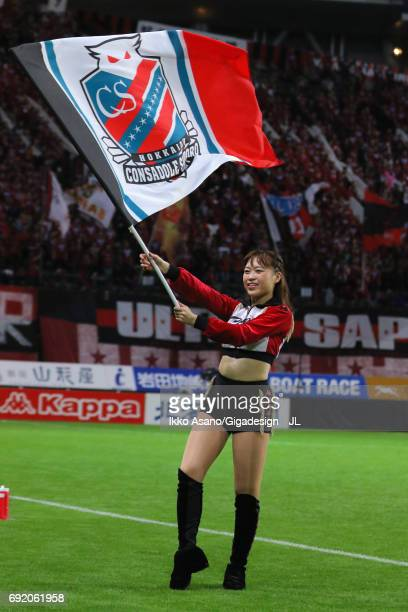 Consadole Sapporo cheer leader wave the flag prior to the JLeague J1 match between Consadore Sapporo and Vissel Kobe at Sapporo Dome on June 4 2017...