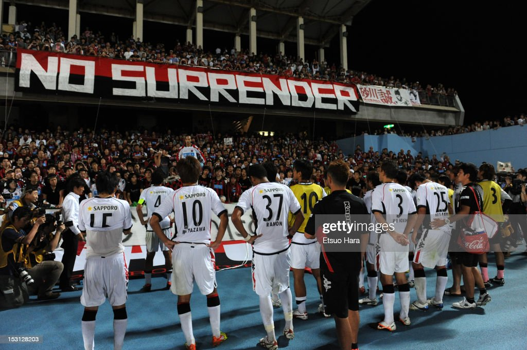 Consadole Sapporo players apologize to the supporters after the JLeague match between Kawasaki Frontale and Consadole Sapporo at Todoroki Stadium on...
