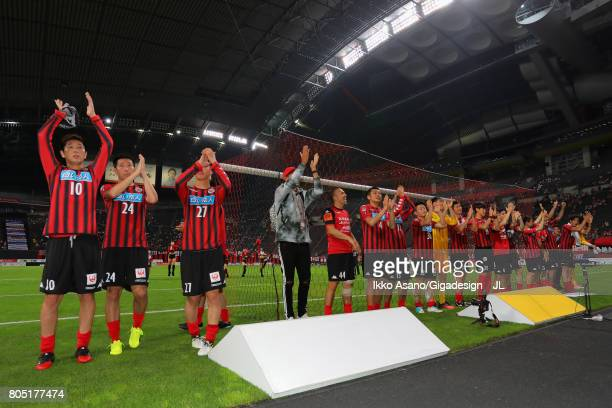Consadole Sapporo players applaud supporters after their 10 victory in the JLeague J1 match between Consadole Sapporo and Shimizu SPulse at Sappaoro...