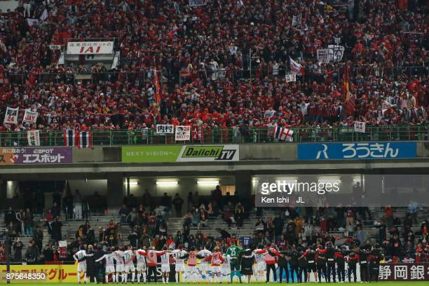 Consadole Sapporo players applaud supporters after their 20 victory in the JLeague J1 match between Shimizu SPulse and Consadole Sapporo at IAI...