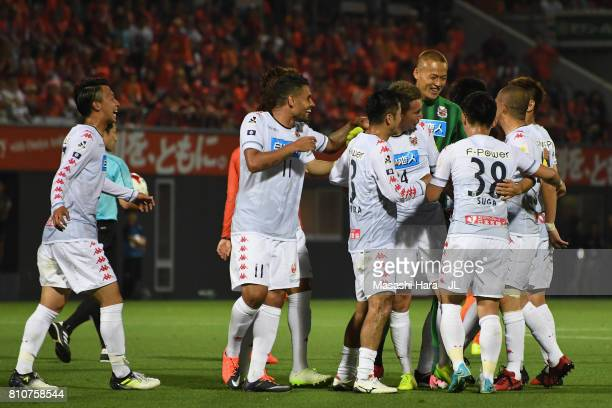 Consadole Sapporo players celebrate as Akito Fukumori scoring his side's second goal during the JLeague J1 match between Omiya Ardija and Consadole...