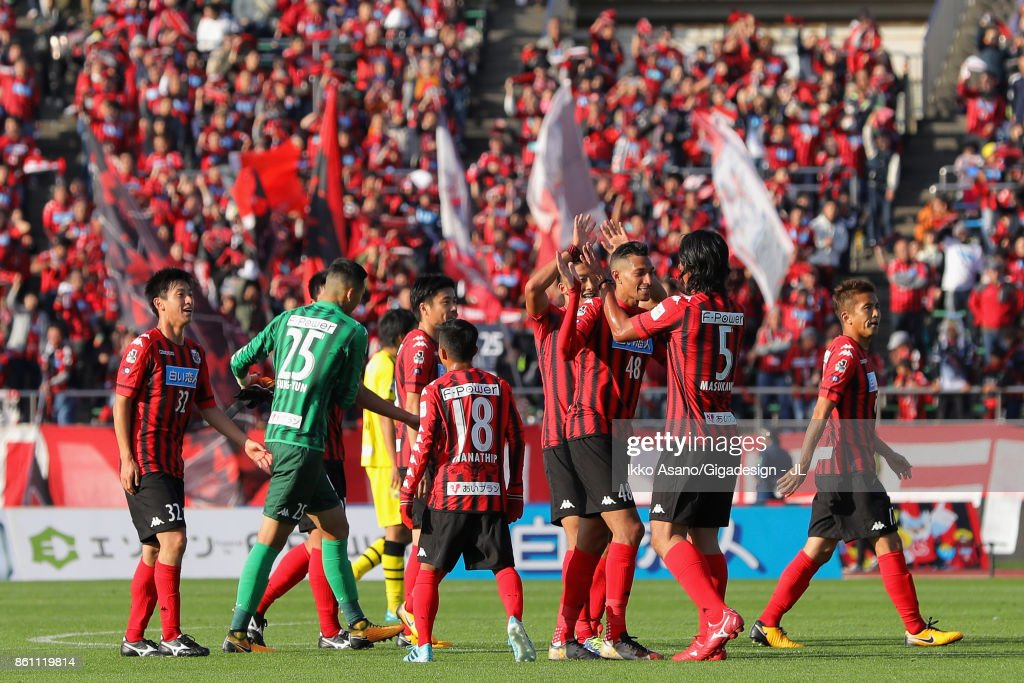 http://media.gettyimages.com/photos/consadole-sapporo-players-celebrate-their-31-victory-after-the-j1-picture-id861119814