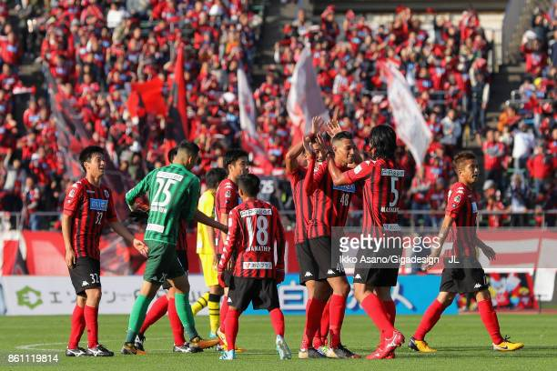 Consadole Sapporo players celebrate their 31 victory after the JLeague J1 match between Consadole Sapporo and Kashiwa Reysol at Sapporo Atsubetsu...