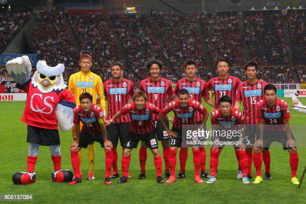 Consadole Sapporo players line up for the team photos prior to the JLeague J1 match between Consadole Sapporo and Shimizu SPulse at Sappaoro Dome on...