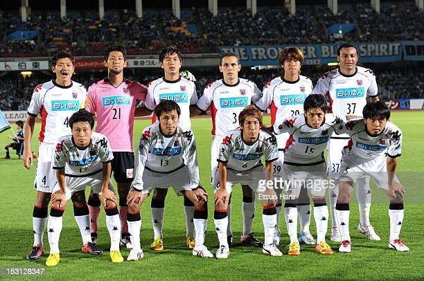 Consadole Sapporo players pose for team photos prior to the JLeague match between Kawasaki Frontale and Consadole Sapporo at Todoroki Stadium on...