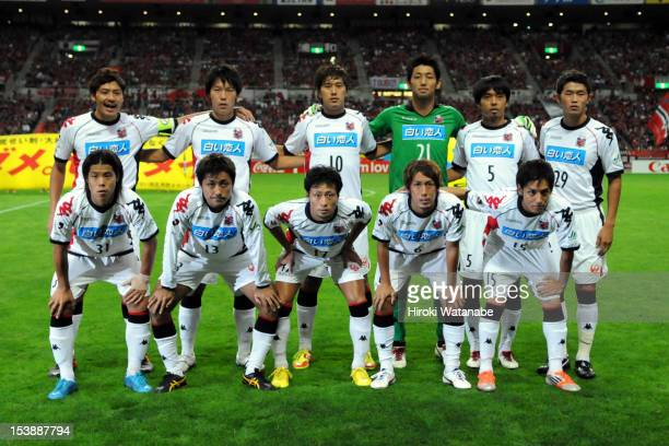Consadole Sapporo players pose for the team photo prior to the JLeague match between Urawa Red Diamonds and Consadole Sapporo on October 6 2012 in...