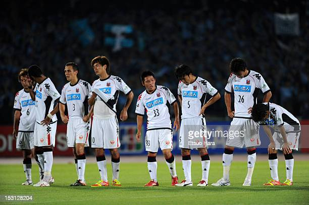 Consadole Sapporo players show their dejections after the JLeague match between Kawasaki Frontale and Consadole Sapporo at Todoroki Stadium on...