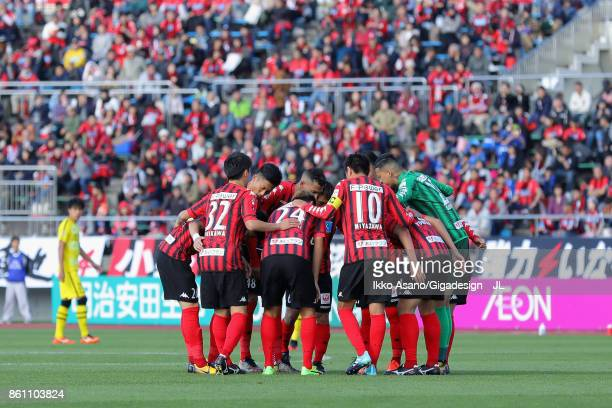 Consadole Sapporo plyaers huddle during the JLeague J1 match between Consadole Sapporo and Kashiwa Reysol at Sapporo Atsubetsu Stadium on October 14...