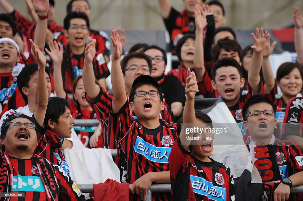 Consadole Sapporo supporters cheer before the J.League second division match between Tochigi SC and Consadole Sapporo at Tochigi Green Stadium on September 15, 2013 in Utsunomiya, Japan.