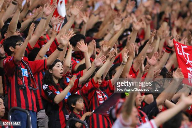 Consadole Sapporo supporters cheer prior to the JLeague J1 match between Consadole Sapporo and Shimizu SPulse at Sappaoro Dome on July 1 2017 in...