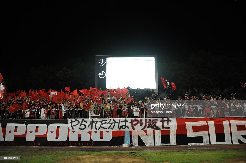 Consadole Sapporo supporters wave flags during the J.League second division match between Tochigi SC and Consadole Sapporo at Tochigi Green Stadium on September 15, 2013 in Utsunomiya, Japan.