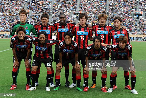 Consadore Sapporo players pose for photographs prior to the JLeague second division match between Yokohama FC and Consadore Sapporo at the National...