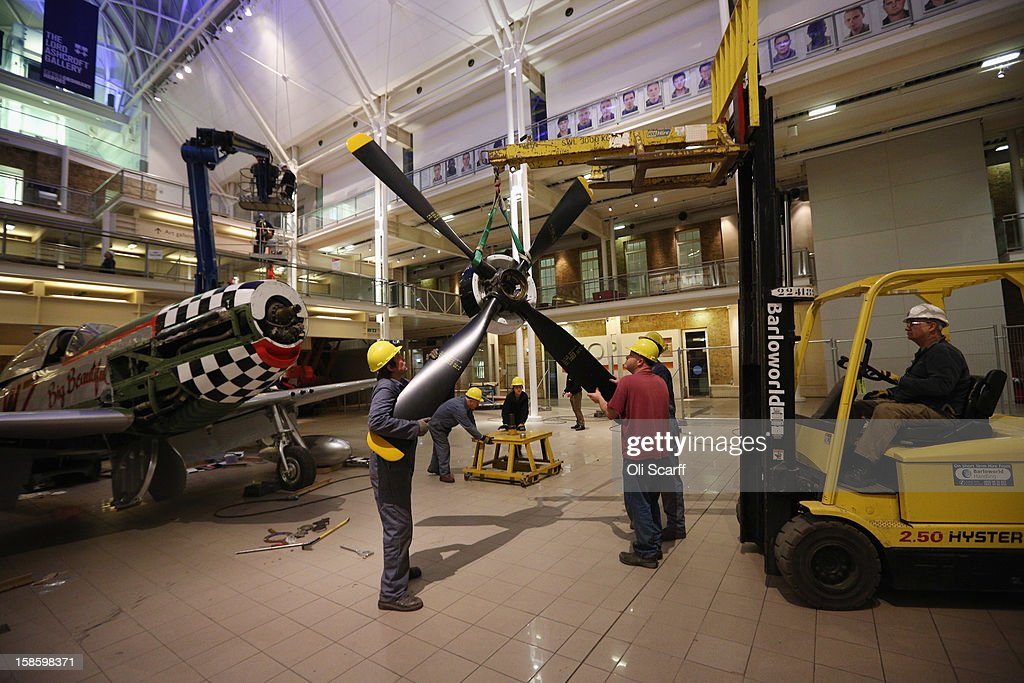Conservation Officers from IWM Duxford remove the propeller from a P51D Mustang fighter aircraft which had been suspended from the roof of the Imperial War Museum on December 19, 2012 in London, England. The aircraft is the last of 65 large objects to be removed from the museum before it undergoes an extensive refurbishment which will see it close for six months from January 2, 2013. The Mustang, which was built in 1951, had been suspended from the Imperial War Museum's roof for the past 20 years.