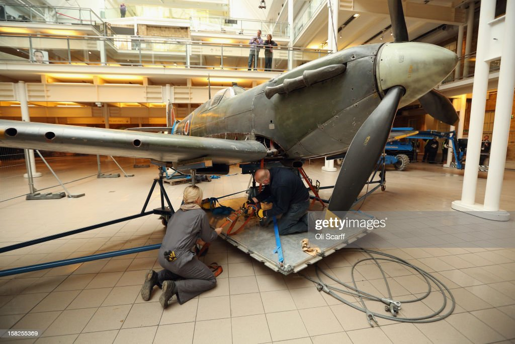 Conservation Officers prepare to remove a wing from a Mk I Spitfire that had been suspended from the ceiling in the Imperial War Museum on December 12, 2012 in London, England. The Spitfire entered service in 1938 with No.19 Squadron and flew in the Battle of Britain during the summer and autumn of 1940. It will be conserved and displayed at IWM Duxford whilst IWM London is closed from January 2, 2013 until July 1, 2013 for a major refurbishment.