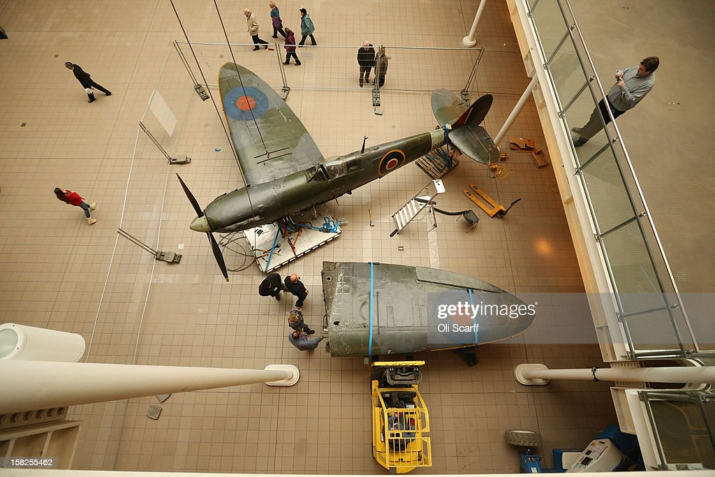 Conservation Officers remove a wing from a Mk I Spitfire that had been suspended from the ceiling in the Imperial War Museum on December 12, 2012 in London, England. The Spitfire entered service in 1938 with No.19 Squadron and flew in the Battle of Britain during the summer and autumn of 1940. It will be conserved and displayed at IWM Duxford whilst IWM London is closed from January 2, 2013 until July 1, 2013 for a major refurbishment.