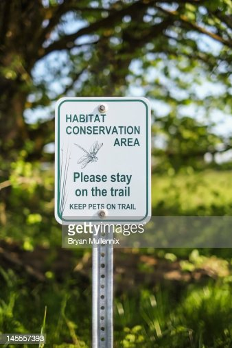 Conservation sign in nature reserve area : Stock Photo