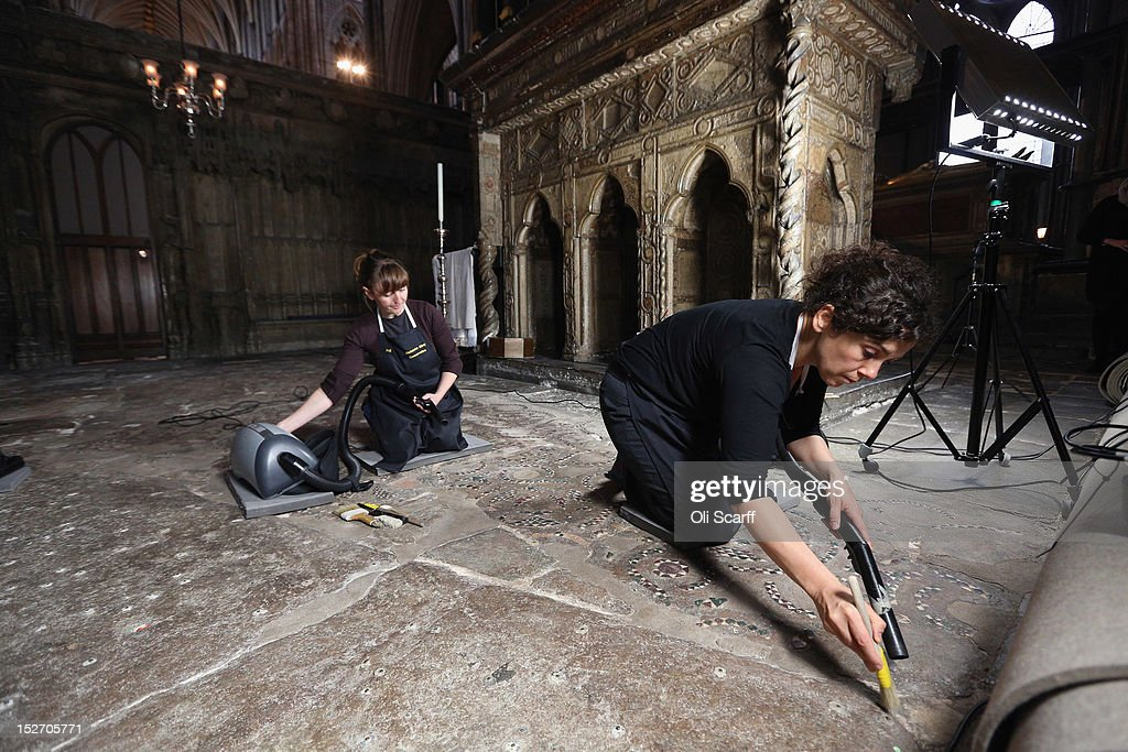 Conservation staff at Westminster Abbey clean the Cosmati pavement surrounding the tomb of Edward the Confessor and asses it for conservation on September 24, 2012 in London, England. The highly decorative stone pavement is formed of small precious stones such as onyx and porphyry on a base of dark limestone, known as Purbeck marble. A shrine was erected in 1163 following the Confessor's canonisation and St Edward's body was brought in on October 13, 1269 to its new resting place.The Cosmati pavement provides the flooring around Edward the Confessor's tomb behind the High Altar of Westminster Abbey where the Duke and Duchess of Cambridge signed their marriage register. The pavement's protective covering has only been raised a small number of times in the past 100 years.
