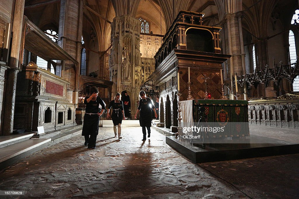 Conservation staff at Westminster Abbey examine the Cosmati pavement surrounding the tomb of Edward the Confessor to asses it for conservation after the removal of its protective covering on September 24, 2012 in London, England. The highly decorative stone pavement is formed of small precious stones such as onyx and porphyry on a base of dark limestone, known as Purbeck marble. A shrine was erected in 1163 following the Confessor's canonisation and St Edward's body was brought in on October 13, 1269 to its new resting place.The Cosmati pavement provides the flooring around Edward the Confessor's tomb behind the High Altar of Westminster Abbey where the Duke and Duchess of Cambridge signed their marriage register. The pavement's protective covering has only been raised a small number of times in the past 100 years.