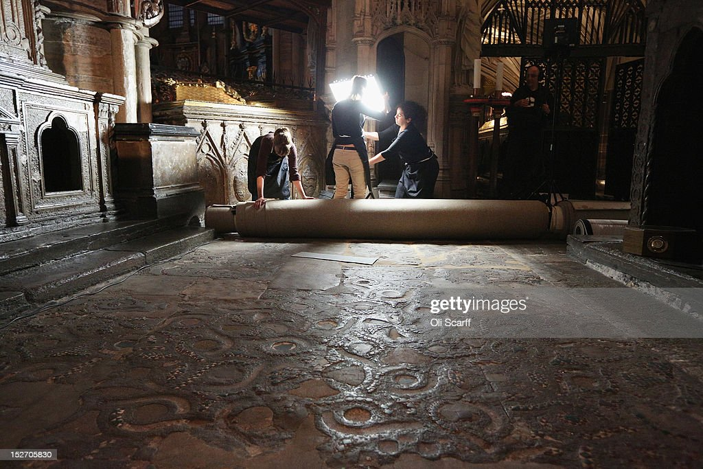 Conservation staff at Westminster Abbey remove the protective covering on the Cosmati pavement surrounding the tomb of Edward the Confessor to asses it for conservation on September 24, 2012 in London, England. The highly decorative stone pavement is formed of small precious stones such as onyx and porphyry on a base of dark limestone, known as Purbeck marble. A shrine was erected in 1163 following the Confessor's canonisation and St Edward's body was brought in on October 13, 1269 to its new resting place.The Cosmati pavement provides the flooring around Edward the Confessor's tomb behind the High Altar of Westminster Abbey where the Duke and Duchess of Cambridge signed their marriage register. The pavement's protective covering has only been raised a small number of times in the past 100 years.