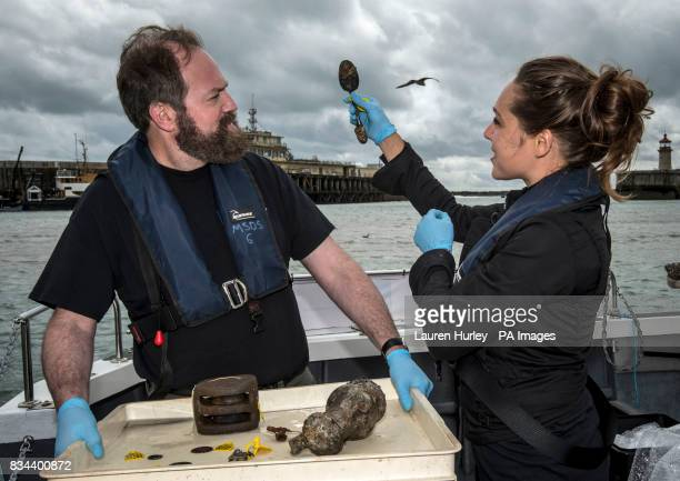 Conservation team members Elisabeth Kuiber and Eric Nordgren with finds including a spoon from the Rooswijk which sank off the Kent coast in 1740 at...