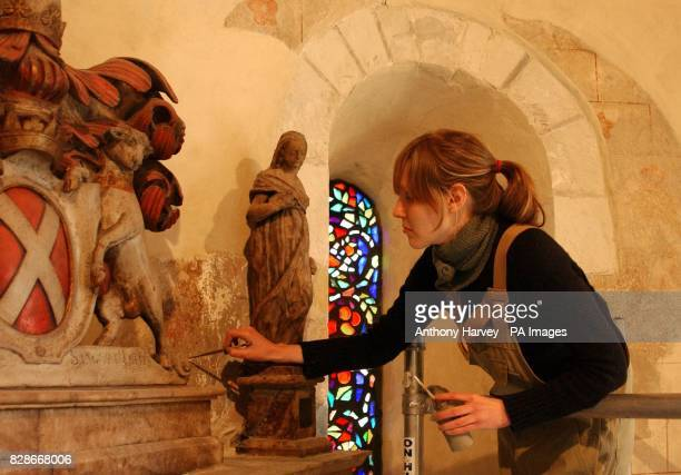 Conservationist Alex Gent works on 700 yearold wall paintings which have been revealed in the historic Grade I listed Norman church of St Mary...
