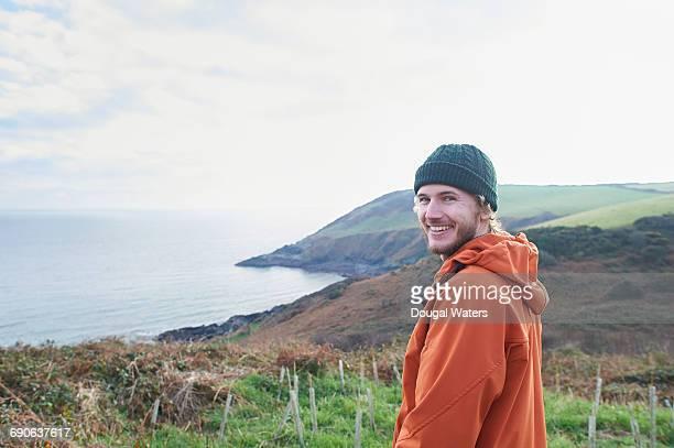 Conservationist on coastline.